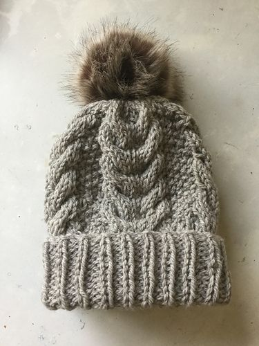 A Snug fit cabled beanie hat with a ribbed double cuff hem. A great essential for Men and Women and super cute on kids. One size fits most and is easily adapted. This is a quick knit, worked on big needles with chunky yarn. Jo x