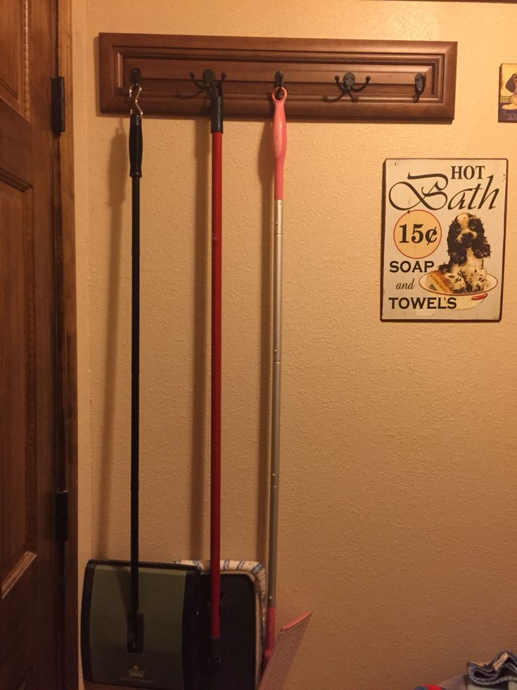 Broom Storage: We have a small laundry room and needed some place to keep brooms, etc. We found a $50 drawer face on clearance for $10, added some hooks (single and double) to maximize usage and hung it behind the door. Loving this!