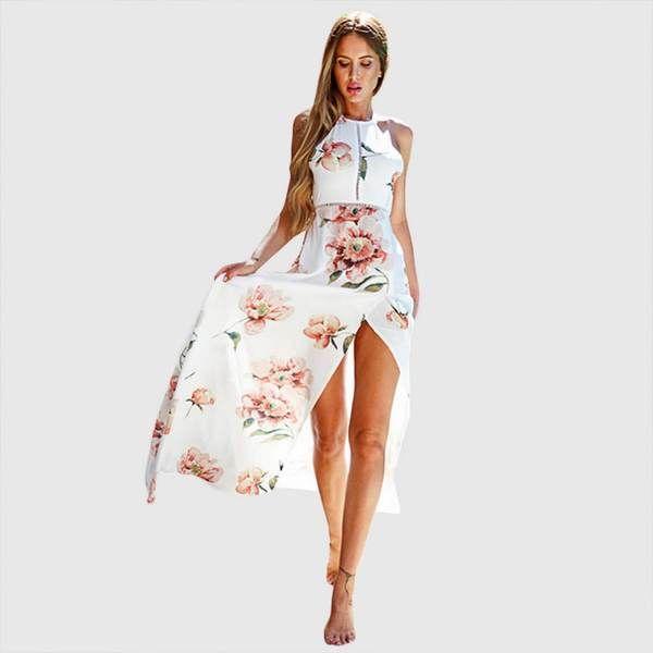 Vestido largo sin mangas con cuello halter. Fabricado en mezcla de algodón, este vestido tiene un estampado floral con apertura en costado de falda y bajo de volado.