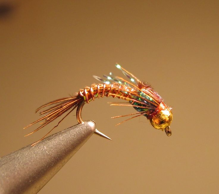 Nice little pheasant tail beadhead nymph with a bit of sparkle to attract the big boys.