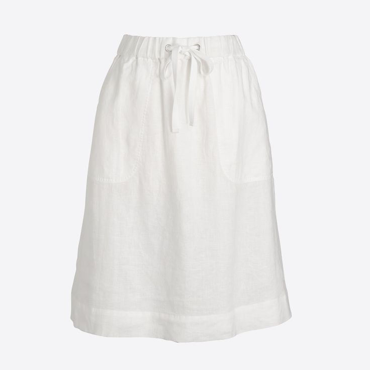 Linen. Fitted at waist. Sits at waist. 22 1/2 long. Falls to knee. Elastic waistband with drawstring. Patch pockets. Lined. Machine wash. Online exclusive. Import.