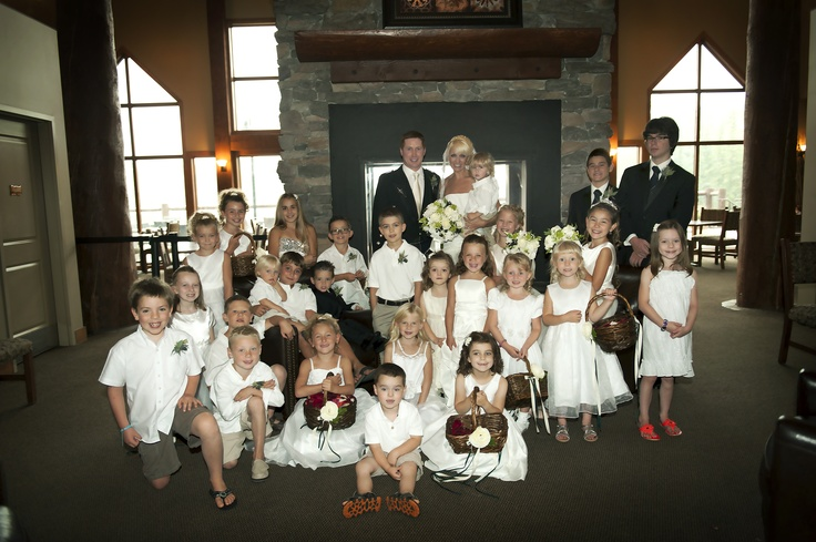 Our fabulous wedding party infront of the impressive fireplace in the Elk Ridge reception area.