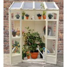Image result for small greenhouses to go against fence