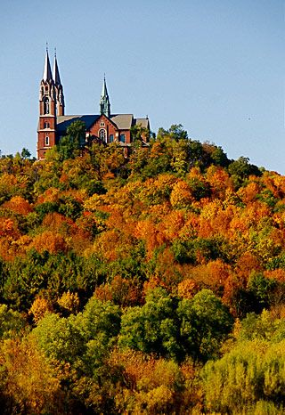 Holy Hill National Shrine of Mary, WI, USA. Holy Hill is approx 110 miles N of Chicago on I-94.From I-94 take I-894 around downtown Milwaukee. (Will be joined by US Hwy 45) . When re-encounter I-94 (East to Milw, West to Madison) continue ahead on Hwy 45 to join with Hwy 41 toward Fond du Lac.