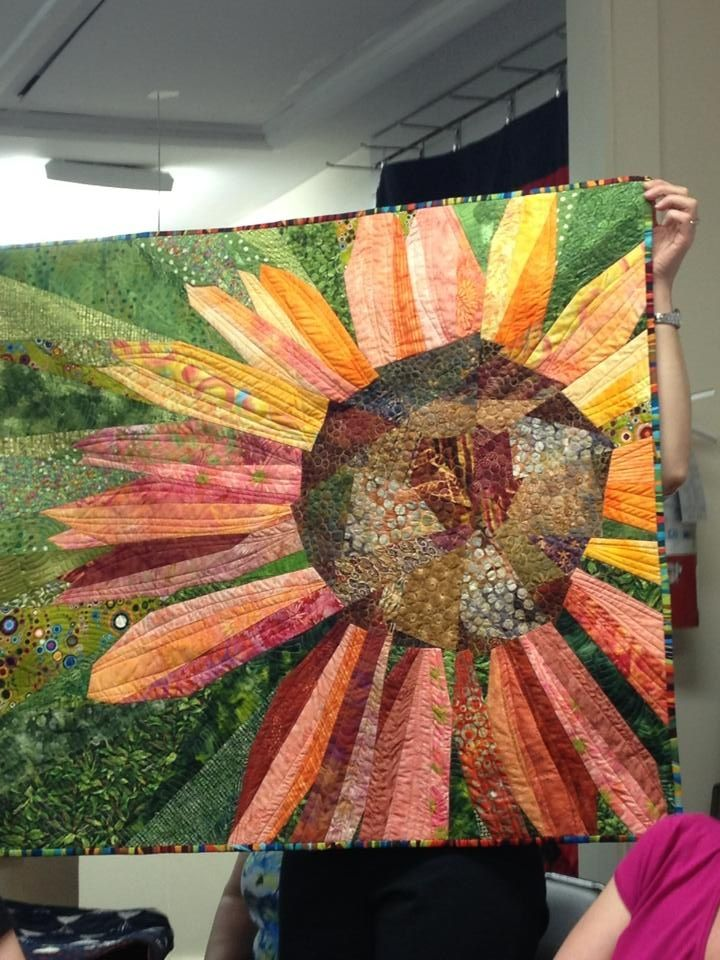 Love this. My Sister-In-Lawe made it and it's one of my all time favorites!!!!!!! Coneflower quilt using Ruth McDowell's piecing method.-