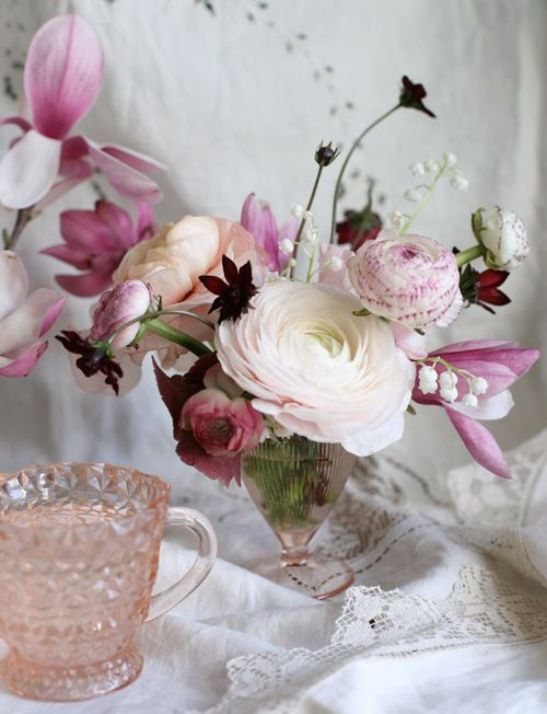 chinese magnolia branches, chocolate cosmos, ranunculus and lilly of the valley in pink depression glass