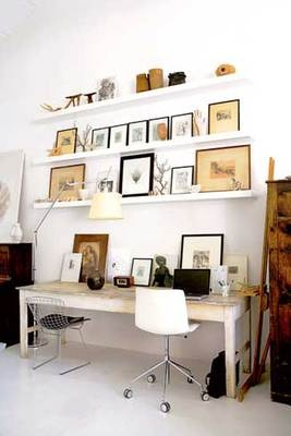 Install shallow display shelves  Organize your home office by maximizing wall space with open shelving. Keep it beautiful by grouping like items together.
