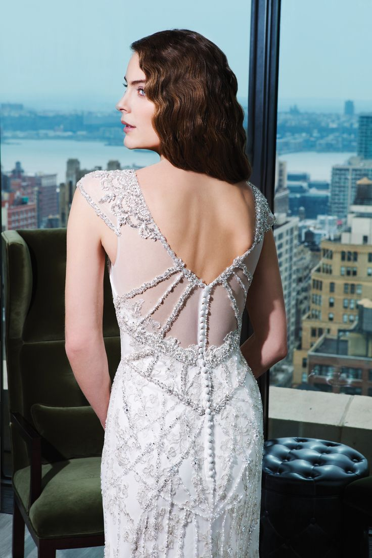 Justin Alexander signature wedding dresses style 9760 �Tulle, beaded embroidery fit and flare dress with a V-neck.