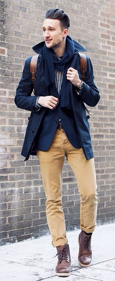 Navy Coat, Mustard Jeans, and Brown Boots. Men's Fall Winter Street Style Fashion.