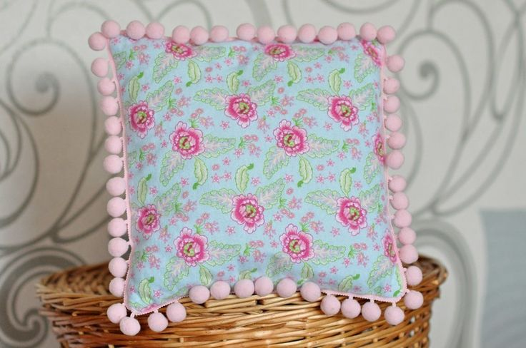 Poduszka z barwnej flaneli z pomponami w LilleBird  na DaWanda.com