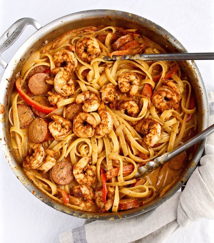 A spicy and creamy cajun shrimp pasta dish with blackened shrimp and andouille sausage.