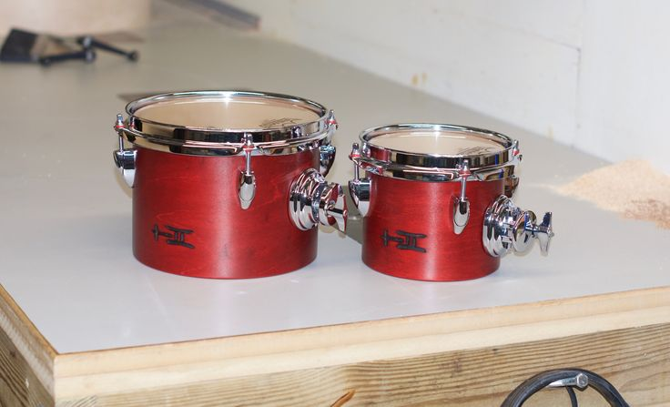 https://flic.kr/s/aHskvdLEYW | Wee Add-Ons | Get your high pitched licks ready to go; made possible by these 6 and 8 inch single headed toms!  5x6, 6x8; plied maple, satin wax. To see more pix, and search our entire TreeHouse archive for your favorite specs, visit our photo gallery:http://www.flickr.com/photos/treehousedrums/collections/