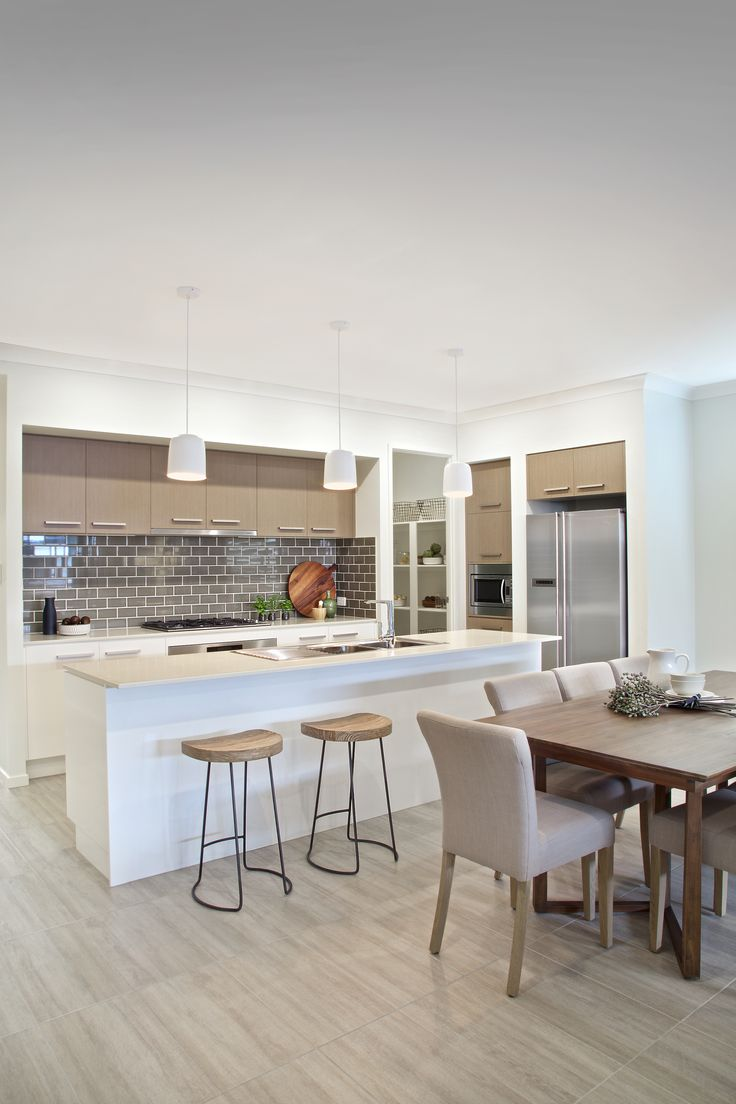 Clarendon Homes.  Terracedale 28.  Neutral coloured kitchen with modern wood and steel combination stools.