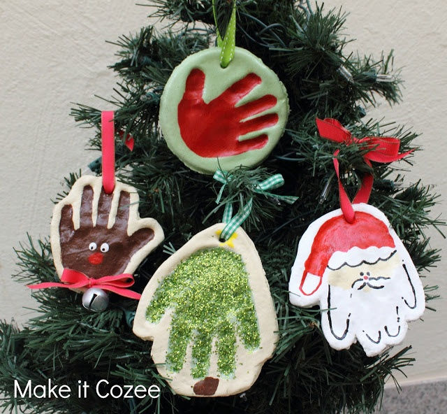 Hand print ornaments.  Step by step tutorial on how to paint the santa.