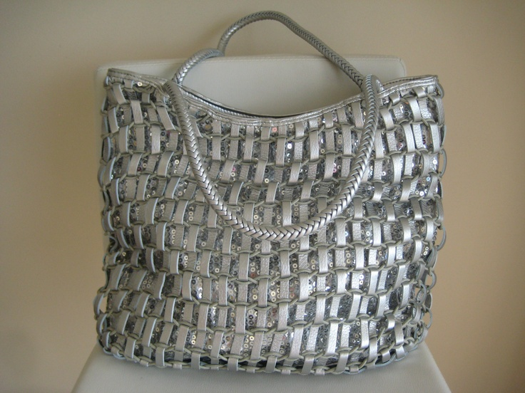 'Threads of Silver' - Bright silver woven shoulder bag with an outer lining of shiny silver sequins and plaited shoulder straps. A fabulous everyday carry-all! Accessorise with a gorgeous pair of silver strappy heels or white sandals with a touch of bling- LUSH! Zip top closure, two internal zip pockets and a further two compartments for a mobile phone, keys, gloss... PERFECT!  RRP $125 www.fb.com/mollyelizadesigns