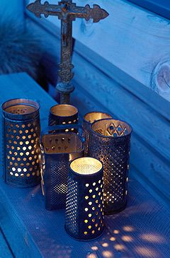 Old Cheesegraters for nightlights.  Brilliant. Like the Morrocan night light holders, but more interesting. Fab for outside dining.