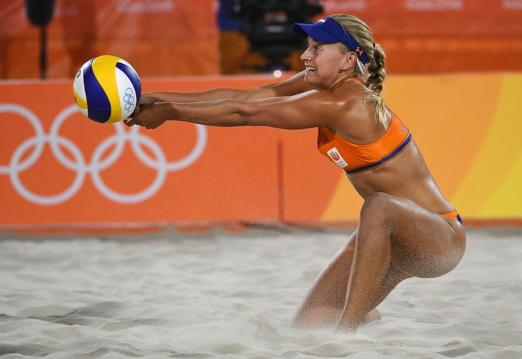 Marleen van Iersel of the Netherlands tries to control the ball during the women's beach volleyball qualifying match
