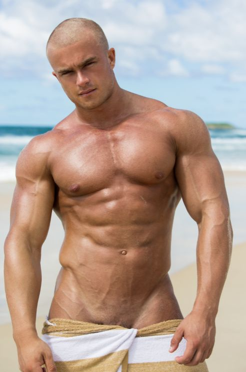 image Bald muscle dude strokes his meat