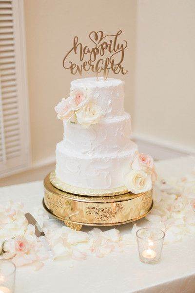 White wedding cake idea - three-tier white wedding cake with white + pink flowers - gold cake stand + gold laser-cut cake topper {Landon Hendrick Photography}