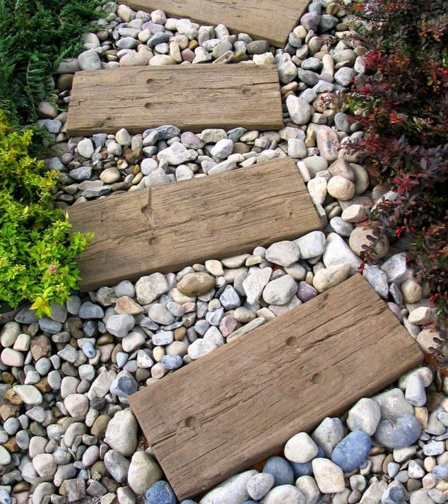 Stone Garden Path Ideas this flagstone path uses pebbles to fill in the gaps between stones 17 Charming Pathways To Make Your Garden The Best In The Neighborhood Pallet Pathpallet Ideasoutdoor