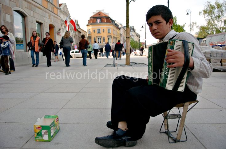 A boy plays for small change in downtown Warsaw, Poland. #realworldphotographs #garymoorephotography #poland #streetphotography #warsaw #photojournalism #Canada