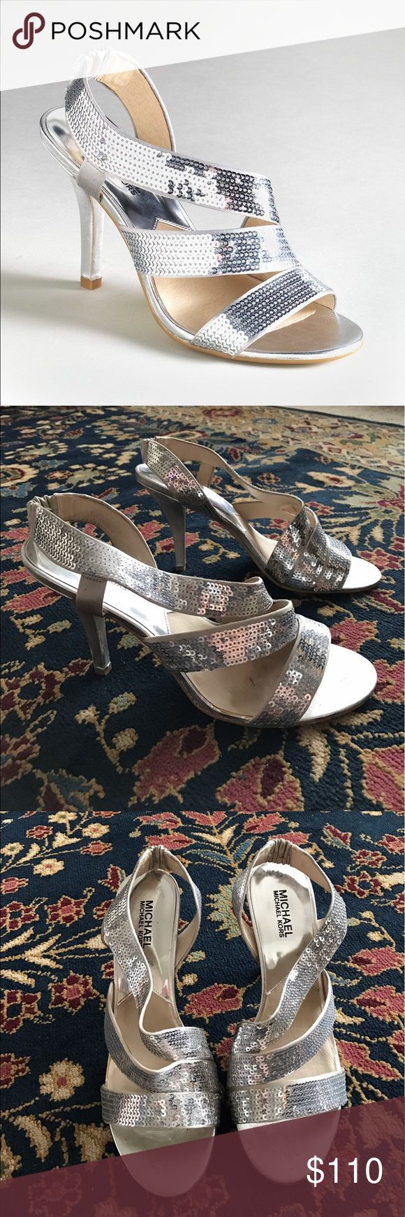 """Michael Kors Farris Womens Silver Sequin Heels Trip the light fantastic in these sequined Farris sandals by Michael Michael Kors. Your feet will fascinate in these strappy sandals, which glitter and gleam with rows of sparkling sequins. Color: silver fabric In excellent condition with minor blips on heel as seen in final photo. Stores with paper stuffing to keep shape.  Brand / Style: Michael Kors Farris Color: Silver Measurements: 4"""" heel Worn once! Elastic at Heel give a secure and…"""