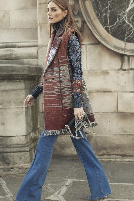 Love her coat and her flare jeans