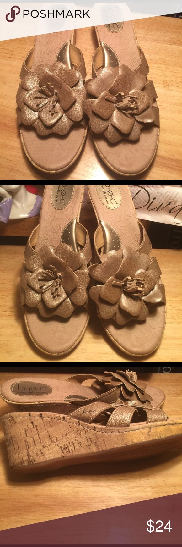 """B.O.C. BORN CONCEPT GOLD WEDGE HEEL SLIDES SZ- 9 B.O.C. BORN CONCEPT GOLD WEDGE HEEL  SLIDES                                                                            These are in excellent used condition.                         SZ- 9  Heel Height - 2 3/4"""" Platform Height - 1"""" Heel To Toe - 10 3/8"""" B.O.C. BORN Shoes Wedges"""