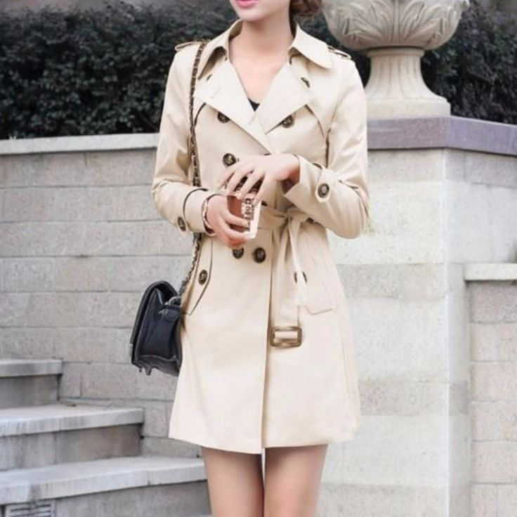 Have fun and stay stylish over this elegant trench coat. This piece have plenty of details that make this a lovely coat, it has a front button tabs that offer a double breasted look, side pockets and