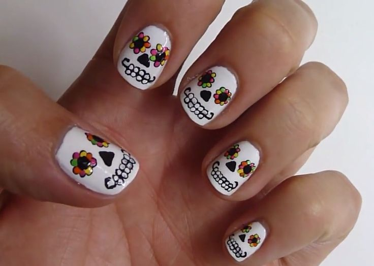 This Day of the Dead nail art is too cool to reserve for Halloween. Youtuber HannahRoxNails carefully paints each sugar skull with a toothpick and shows you how to re-create the look in this video. The bright colors make this funky manicure perfect for a summer festival.