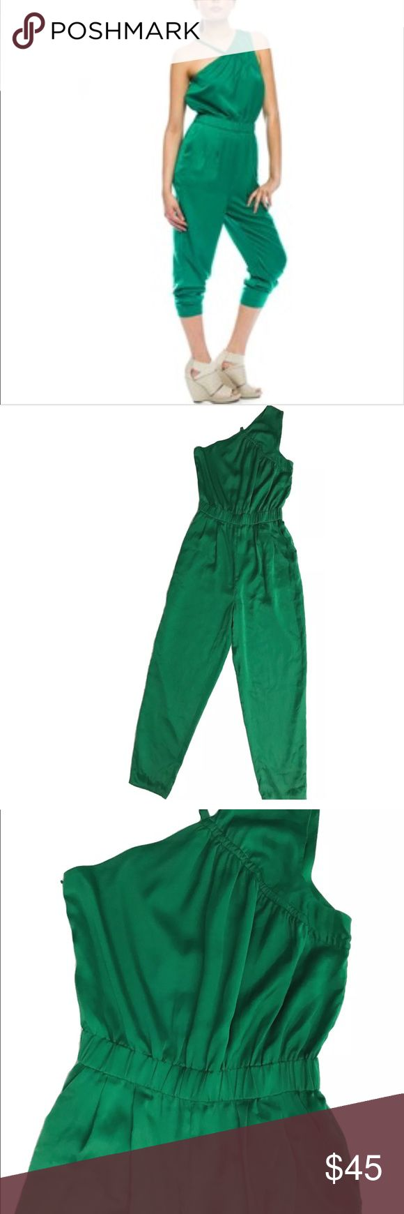 Armani Exchange size 0 green jumpsuit Excellent condition  Unique and trendy Silky like material  Polyester  All seasons garment Please look at pictures for details. A/X Armani Exchange Pants Jumpsuits & Rompers