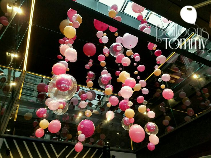 Pink and gold floating balloon garlands to mimic champagne for Balloon decoration chicago