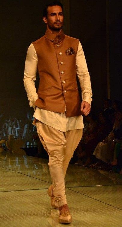 Originally jodhpuri pants were fashioned for horse riders (Royal families). They are lose around the hips and taper as they reach the ankles. They may or may not be crimpled around the ankles.