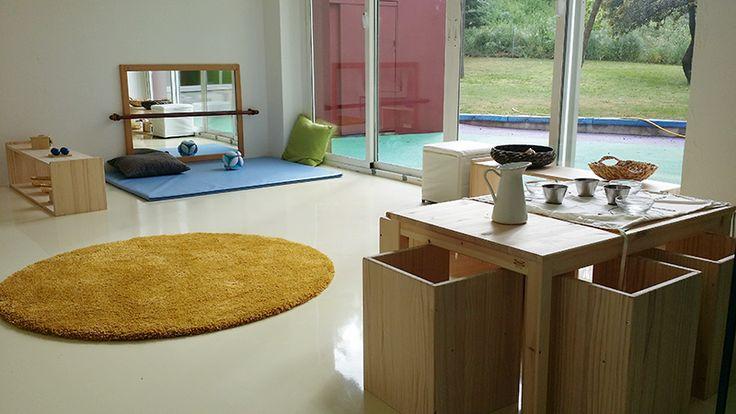 Montessori nido classroom with windows