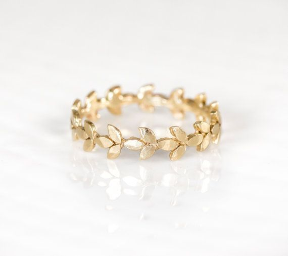 The organic leaves that make up this 14k gold wedding band wrap all the way around the finger. This gold ring is lightly hammered to give character and unique texture, so when polished this 14k gold w