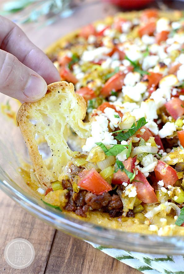 5 Layer Baked Hummus Dip takes just 15 minutes to assemble, 15 minutes to bake and can be completely made ahead of time! | iowagirleats.com
