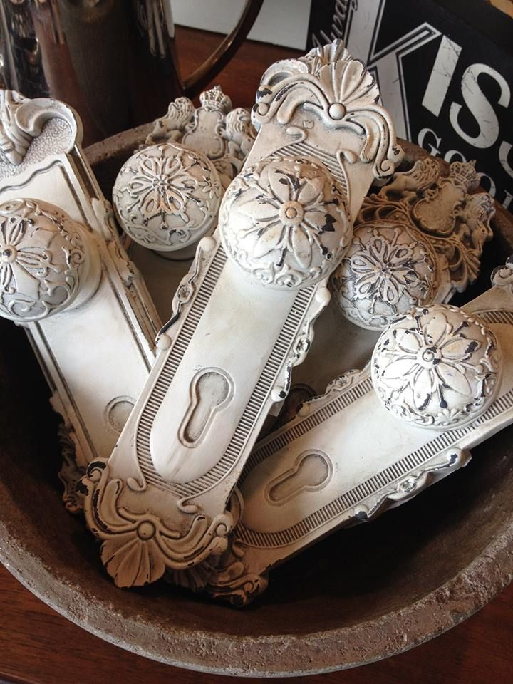 Basket of antique white door knobs and plates