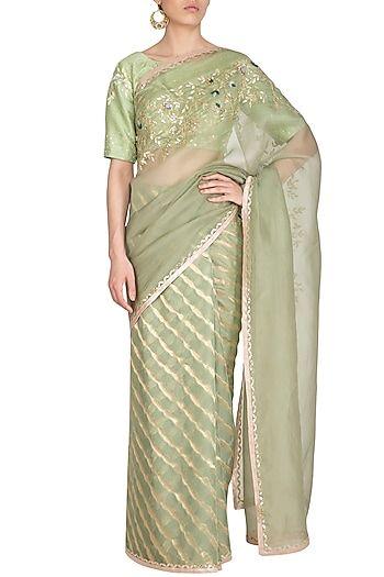 977fa9bf95 Featuring a sage green saree in woven zari leheriya fabric with organza  pallu, champagne gota
