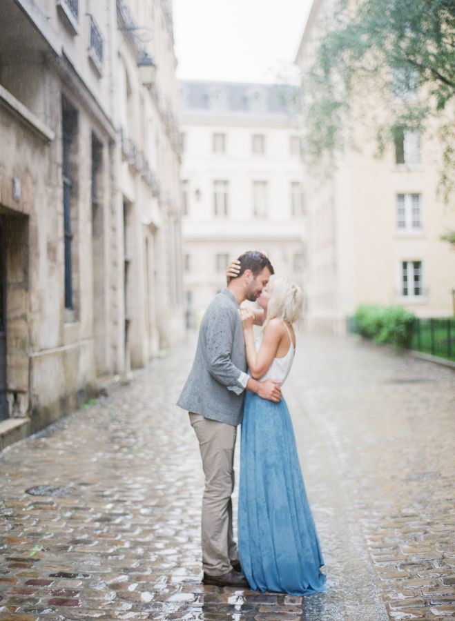 Beautiful rainy engagement session: http://www.stylemepretty.com/little-black-book-blog/2016/08/25/rainy-paris-anniversary-session/ Photography: Peter & Veronika - http://peterandveronika.com/language/en/
