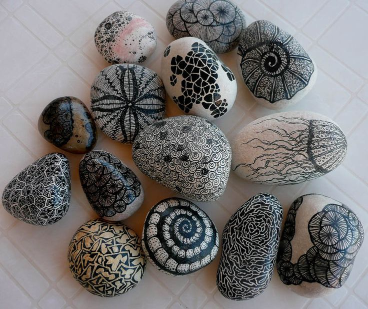Doodle designs on stones with a Sharpie