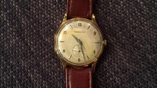 Goldene Herrenuhr, ca. 1950-60, JAEGER LE COULTRE - 18 Karat Gold - Plexiglas - Handaufzug -  Wert 700 € - die Schweizer Uhrenmanufaktur ging 1937 aus Jaeger und LeCoultre hervor.