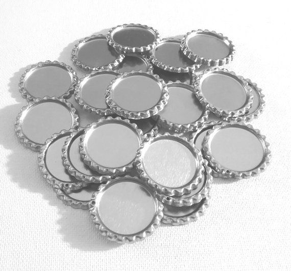 Check out this item in my Etsy shop https://www.etsy.com/ca/listing/261202587/25-shiny-flat-bottle-caps-with-hole-diy