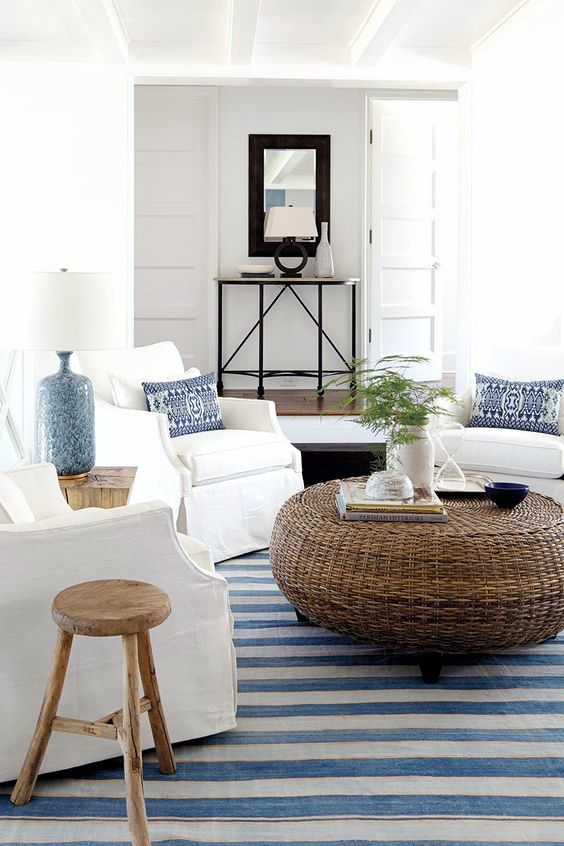 I love the use of natural elements, like the rattan coffee table in coastal decor.