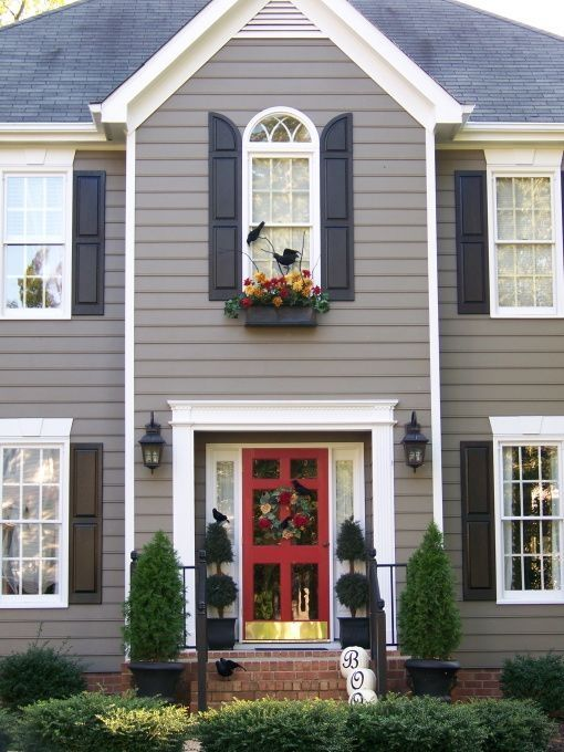 Coral front door , with grey siding n black shutters n trim