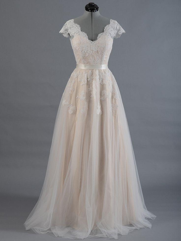 17 seriously stunning wedding dresses under $500   2. Lace Wedding Dress With V-Back, $349.99, ELDesignStudio on Etsy