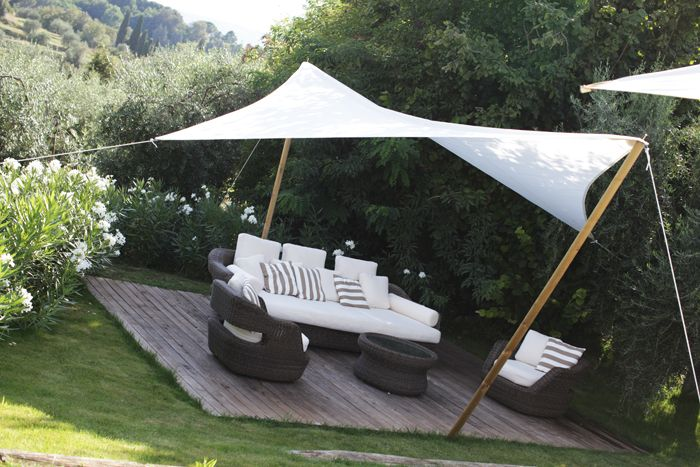 If you need privacy from above, a simple shade sail can be bought or made and installed to provide respite from the midday sun, and give you privacy from units above. You can make a shade sail out of a single canvas drop cloth and a few accessories that you will find at your local Builders or hardware store.