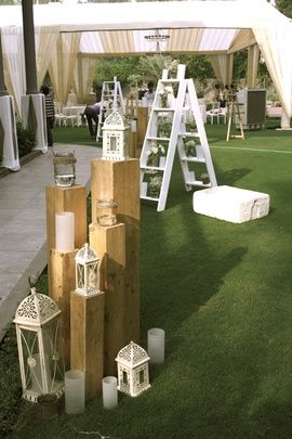 Wedding Decor - British Inspired Indian Wedding Decor, with Lanterns, White Candles, White Wooden Ladder and Plants, White Curtain Canopy And Fountain | WedMeGood Decor by Aura by Gautam Vedi. Find more wedding decor designs on wedmegood.com. #wedmegood #decor #weddingdecor #wmg
