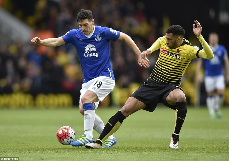 Gareth Barry (left), Everton's defensive midfielder, keeps the ball away from Watford's Etienne Capoue