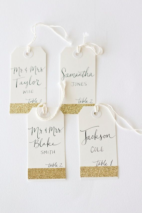 I love these Glitter Escort Tags with Custom Calligraphy for Wedding Event Party or Shower with Name and Table Number on Etsy, $2.50