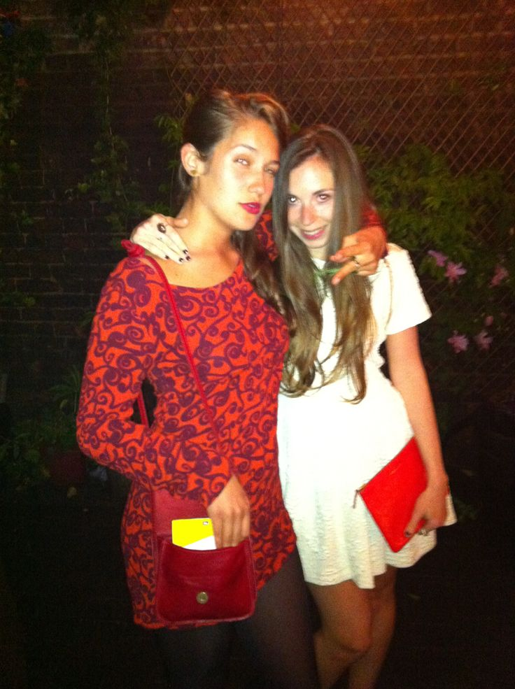 Wearing a white Opening Ceremony Dress and red Comme Des Garcons Purse and with the beautiful Lola Kirke X